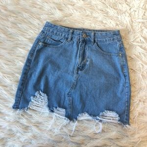 Distressed cut off jean mini skirt